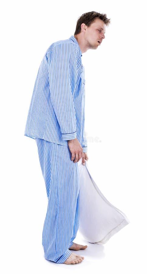 Hombre en cama en pijamas fotografía de archivo libre de regalías