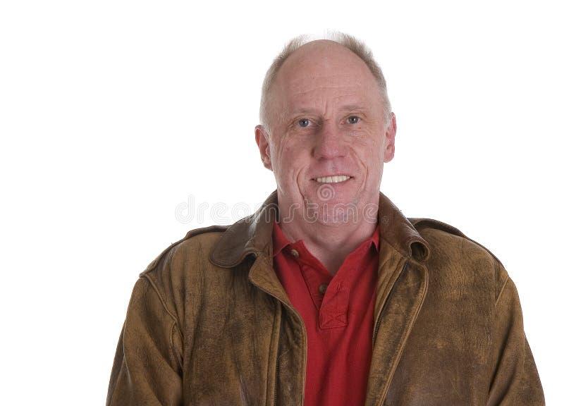 Hombre en la sonrisa de la chaqueta de bombardero fotografía de archivo