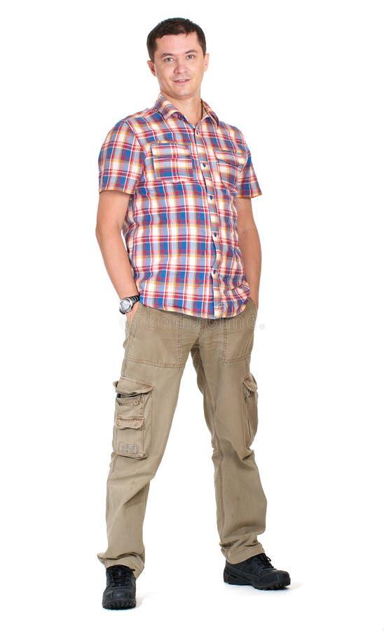Hombre en los pantalones del cargo aislados encendido fotografía de archivo