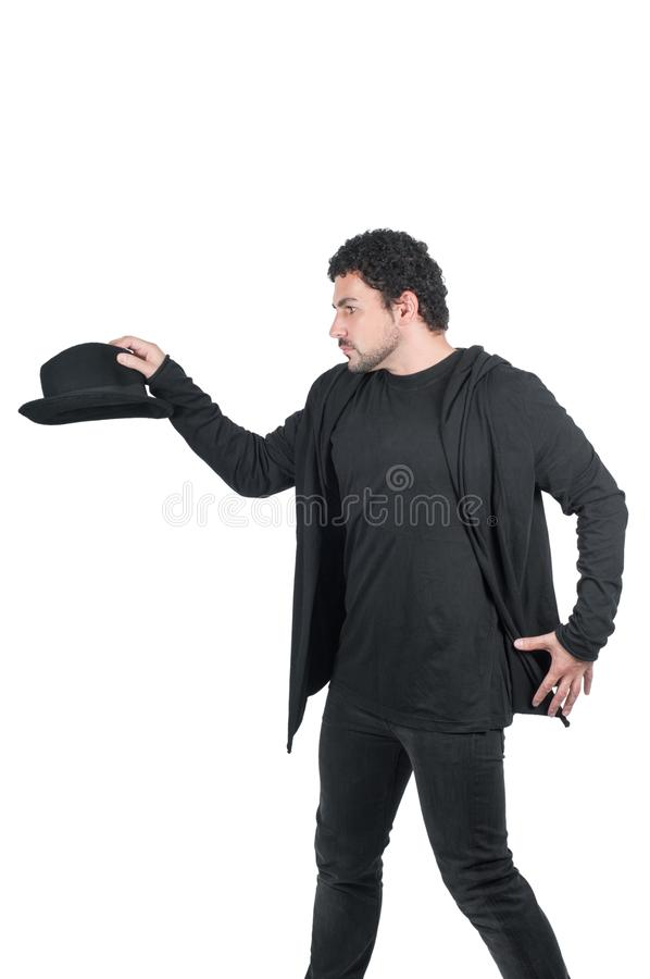 Hombre en negro con su sombrero negro fotografía de archivo libre de regalías