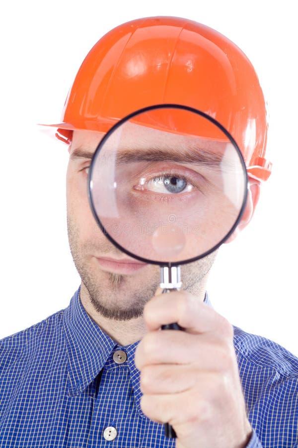 Hombre en sombrero con el ojo magnificado fotografía de archivo libre de regalías