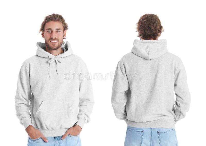 Hombre en suéter en blanco de la sudadera con capucha en las opiniones blancas del fondo, delanteras y traseras imagenes de archivo