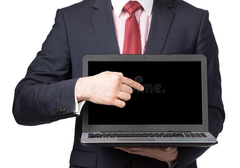 Hombre en traje con el ordenador portátil imagen de archivo