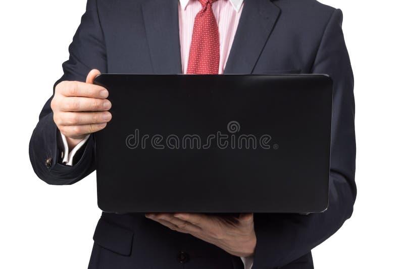 Hombre en traje con el ordenador portátil fotografía de archivo libre de regalías