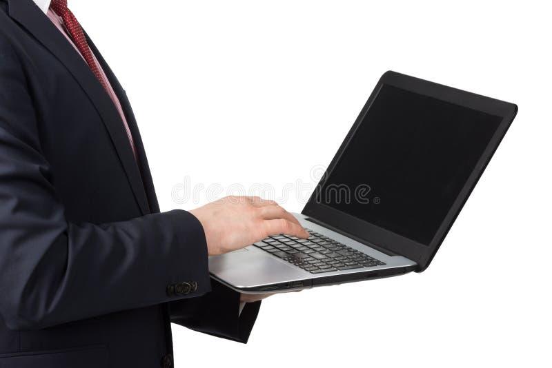 Hombre en traje con el ordenador portátil imagenes de archivo