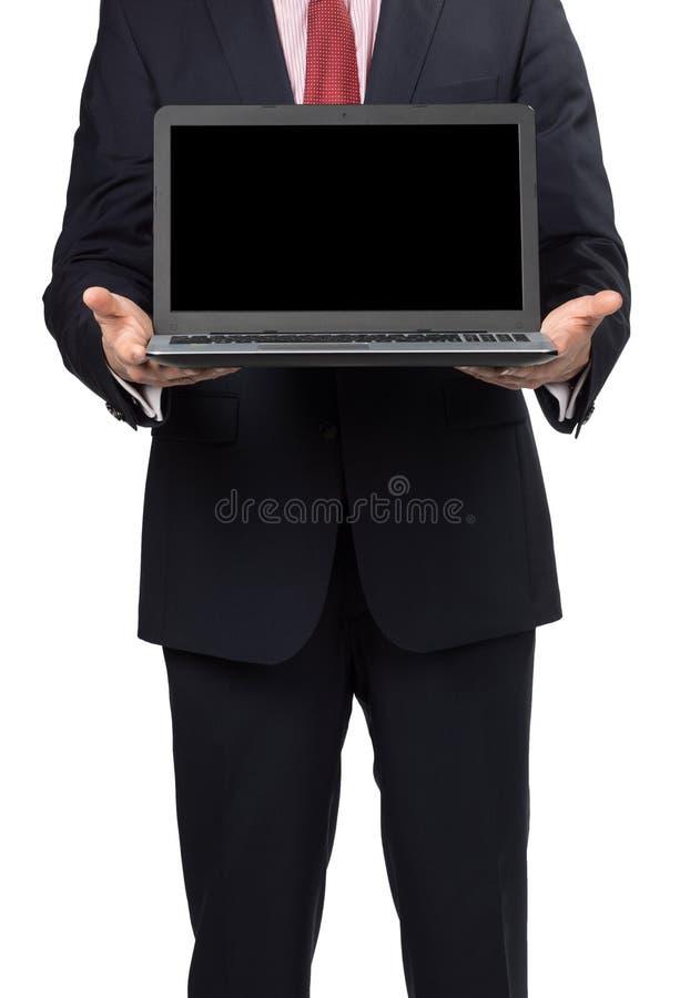 Hombre en traje con el ordenador portátil fotos de archivo libres de regalías