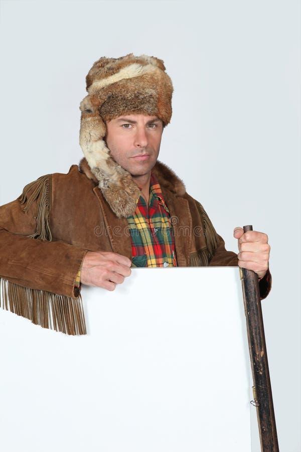 Hombre en traje del trampero imagen de archivo