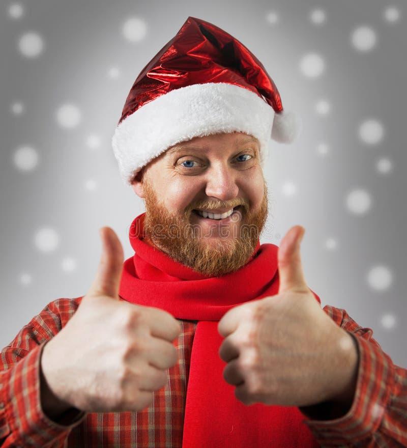 Hombre en un sombrero Papá Noel imagen de archivo