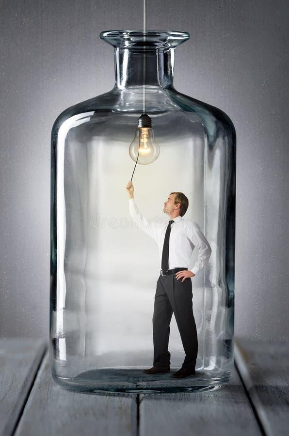 Hombre en una botella foto de archivo libre de regalías