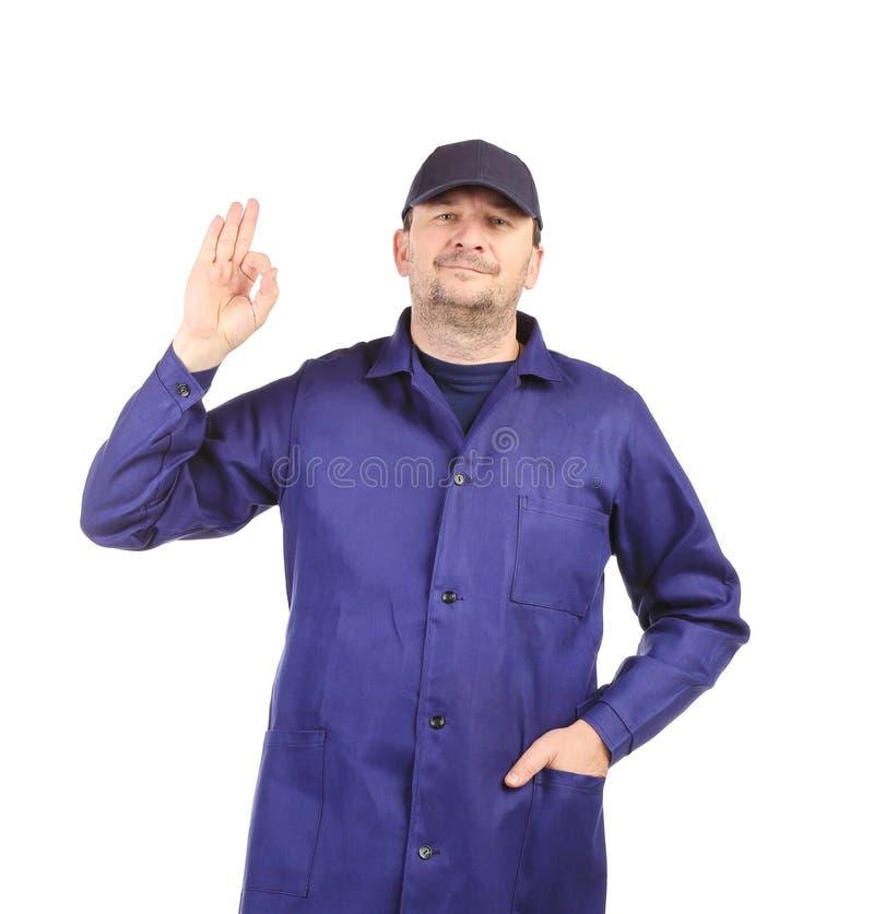 Hombre en uniforme y casquillo. imágenes de archivo libres de regalías