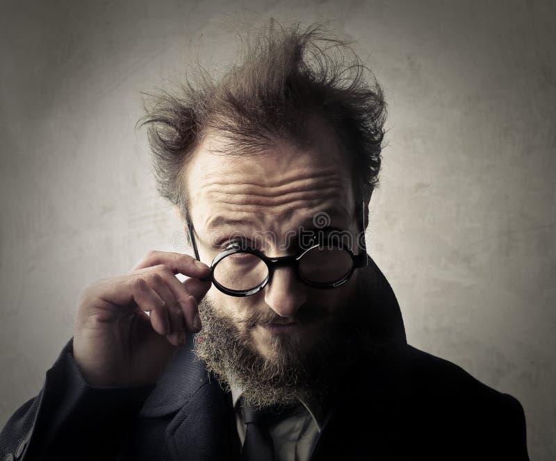 Hombre en vidrios fotografía de archivo libre de regalías