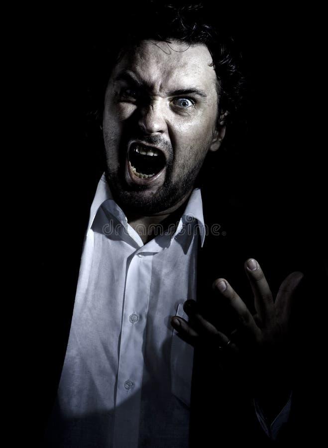 Hombre enojado imagen de archivo