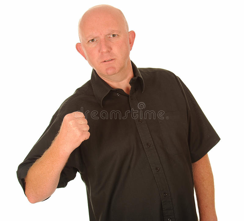 Hombre enojado con el puño apretado foto de archivo libre de regalías