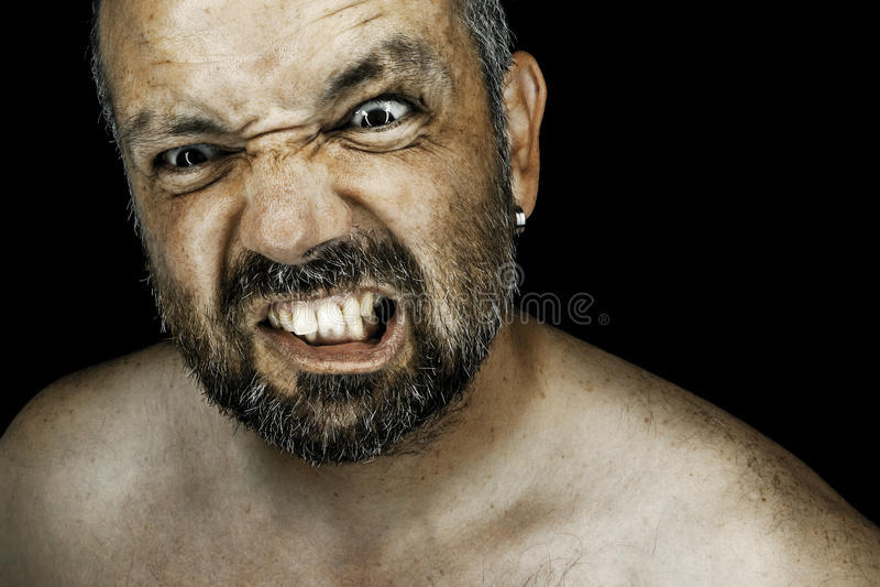 Hombre enojado con la barba fotos de archivo