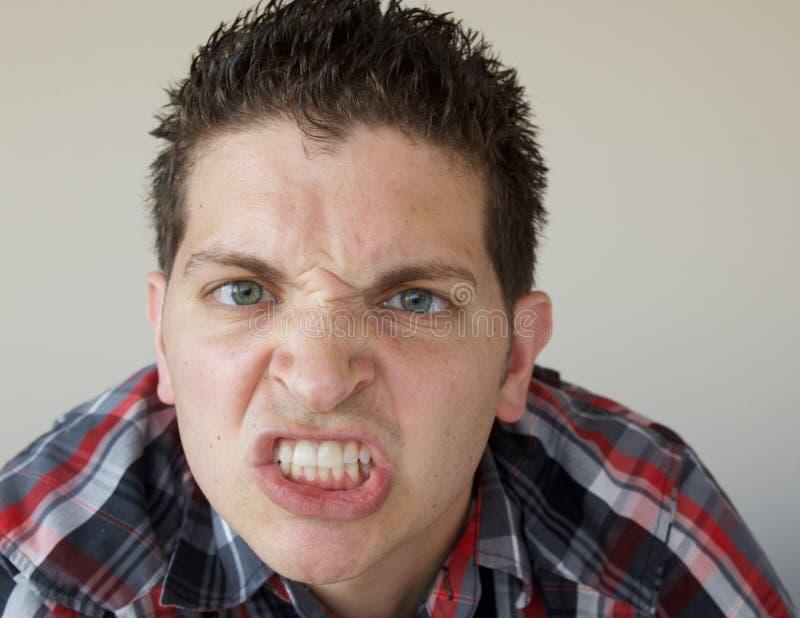 Hombre enojado joven imagen de archivo