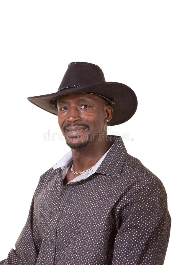 Hombre envejecido centro que lleva un sombrero de vaquero imagenes de archivo