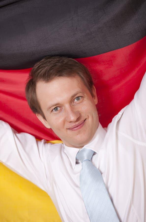 Hombre fanático con el indicador alemán imagen de archivo libre de regalías