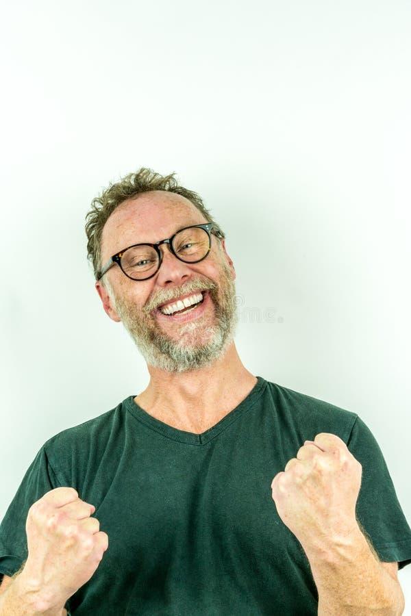 Hombre feliz con la barba, sonrisa que gana fotografía de archivo