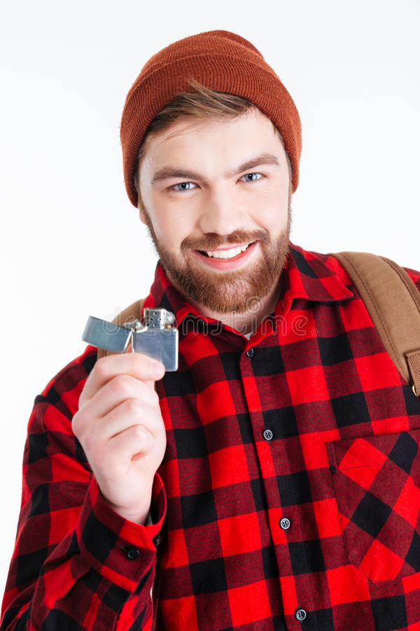 Hombre feliz del inconformista que sostiene el encendedor de gas imagenes de archivo