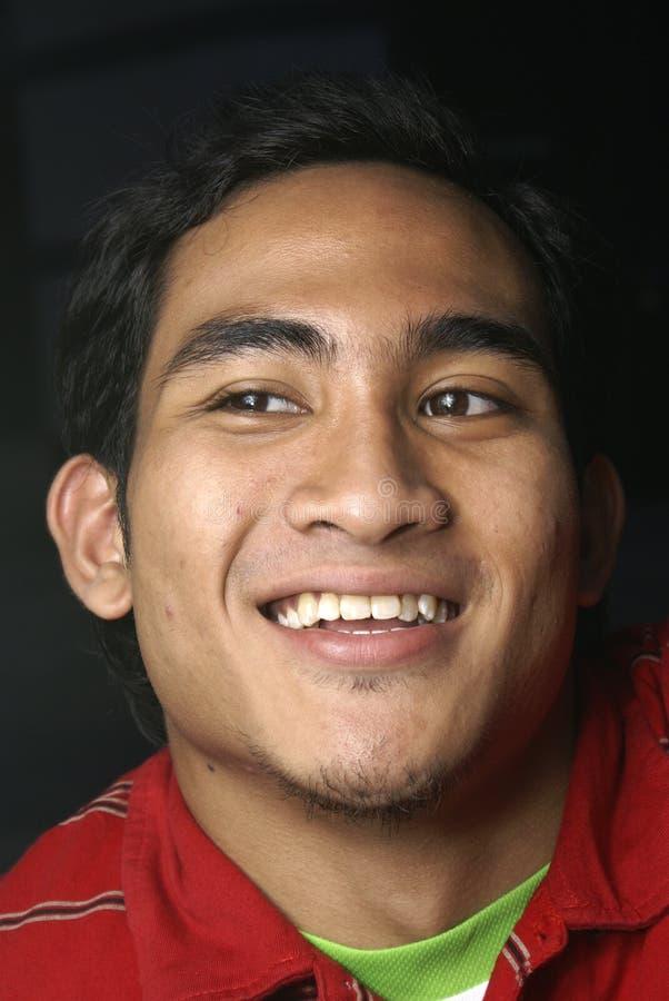 Hombre feliz del malay fotografía de archivo libre de regalías