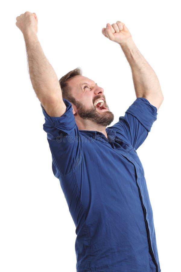 Hombre feliz eufórico que aumenta los brazos aislados foto de archivo