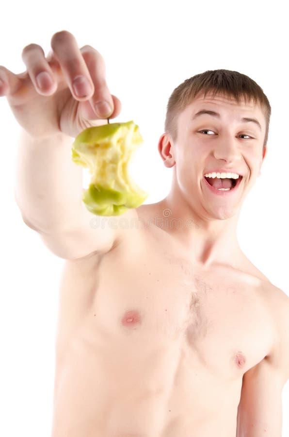 Hombre feliz que sostiene la manzana verde foto de archivo