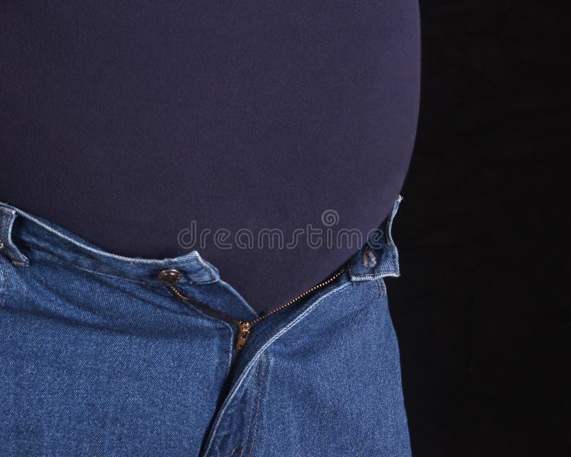 Hombre gordo con la proyección del estómago imagen de archivo libre de regalías