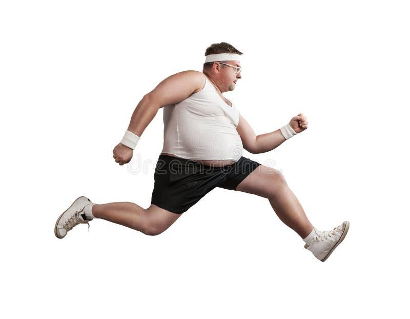 Hombre gordo divertido en el funcionamiento fotografía de archivo libre de regalías