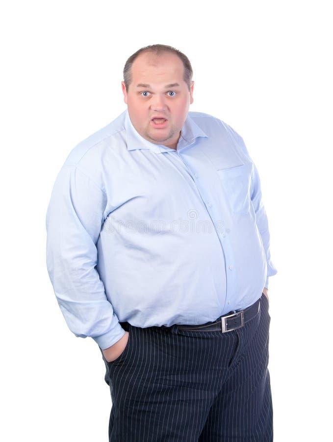Hombre gordo en una camisa azul fotos de archivo libres de regalías