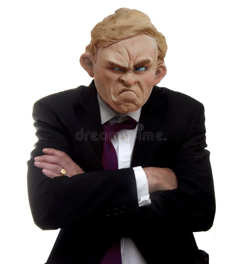 Hombre gruñón con los brazos cruzados fotografía de archivo libre de regalías