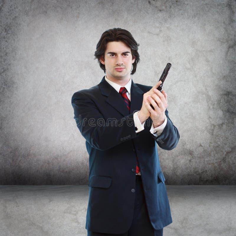 Hombre hermoso con un arma de la mano fotos de archivo libres de regalías