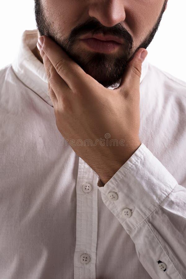 Hombre hermoso en estudio foto de archivo