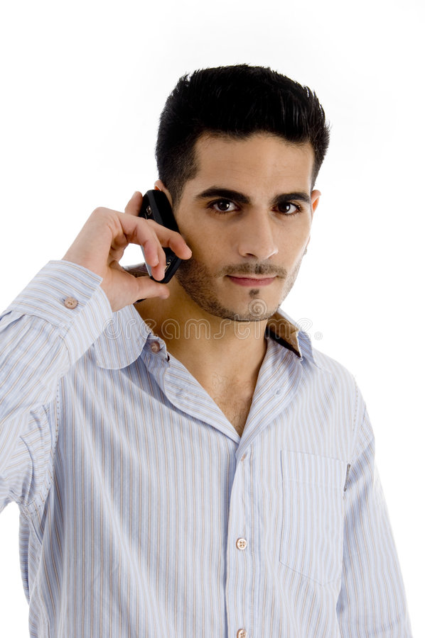 Hombre hermoso que habla en el teléfono celular foto de archivo libre de regalías