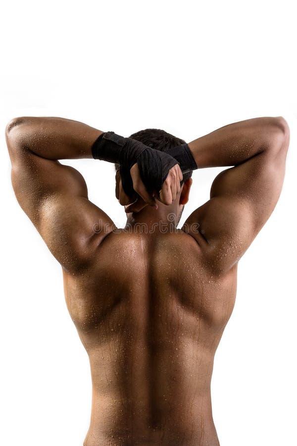 Hombre hermoso que muestra sus músculos fotografía de archivo libre de regalías