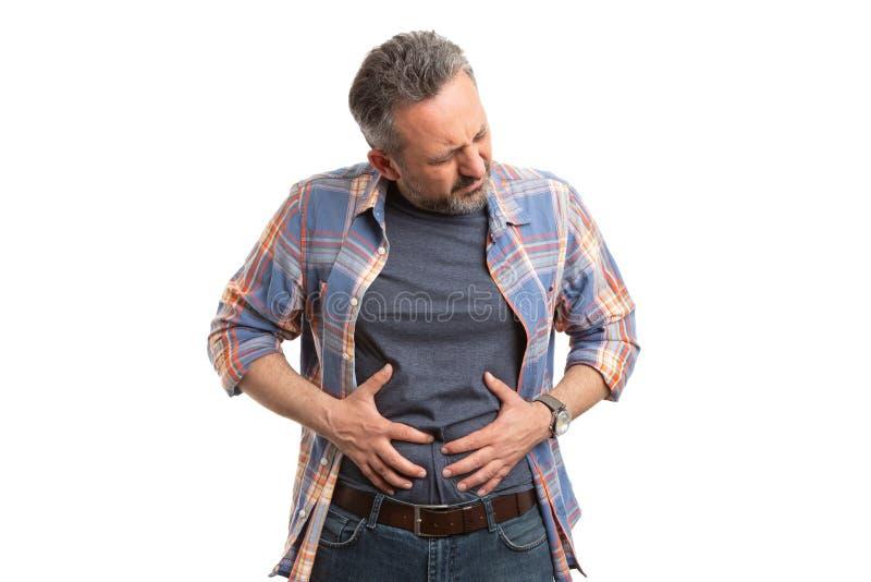 Hombre hinchado que toca el abdomen fotografía de archivo libre de regalías