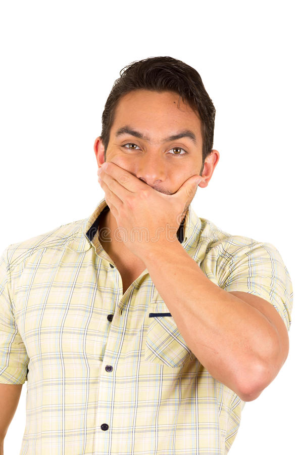 Hombre hispánico hermoso joven que expresa sorpresa imagen de archivo