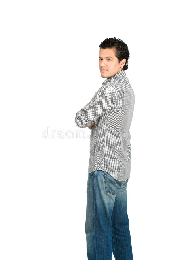 Hombre hispánico reservado en la cámara sobre el hombro V imagen de archivo