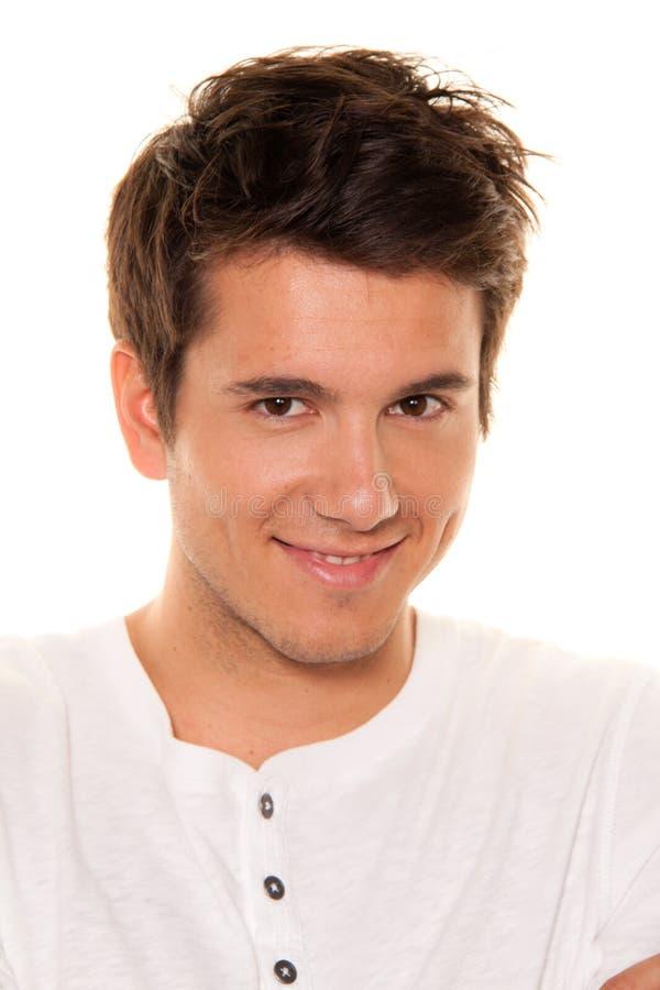 Hombre joven, agradable, sonrisa cómoda. Retrato imágenes de archivo libres de regalías