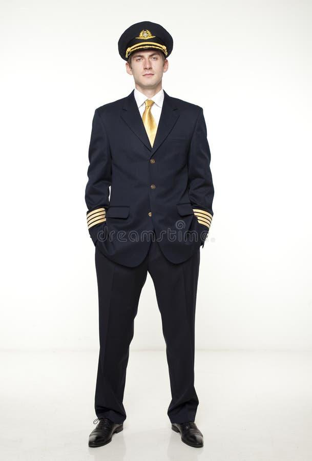 Hombre joven bajo la forma de piloto del avión de pasajeros imagen de archivo