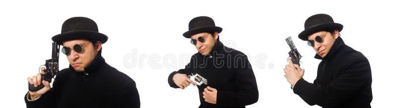 Hombre joven con el arma aislado en blanco foto de archivo