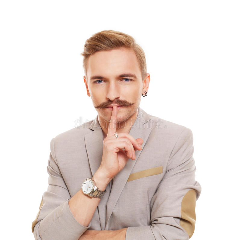 Hombre joven con el bigote aislado en el blanco imagen de archivo libre de regalías