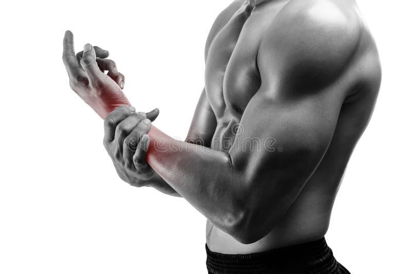 Hombre joven con el dolor de la mano, aislado en el backgr blanco imagenes de archivo