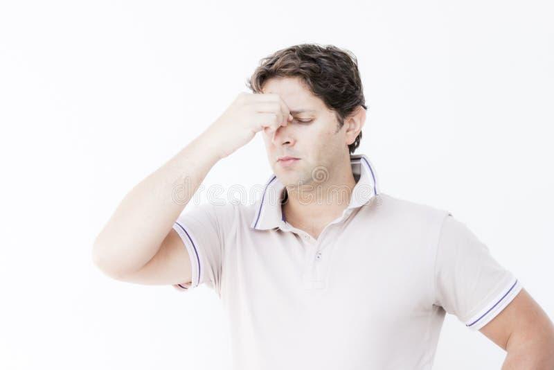 Hombre joven con el dolor principal imagen de archivo