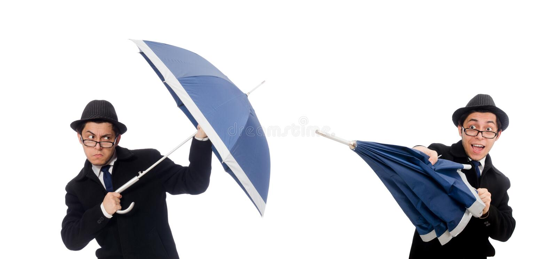 Hombre joven con el paraguas aislado en blanco fotos de archivo libres de regalías