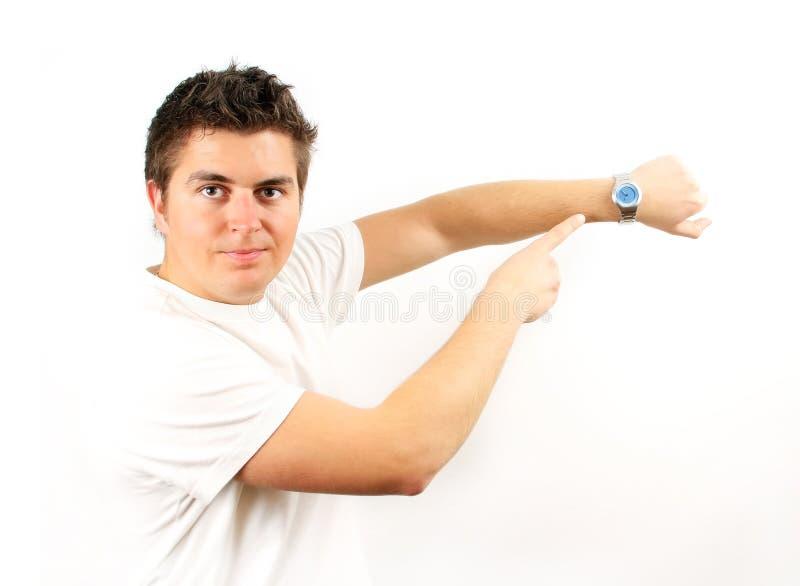 Hombre joven con el reloj fotografía de archivo