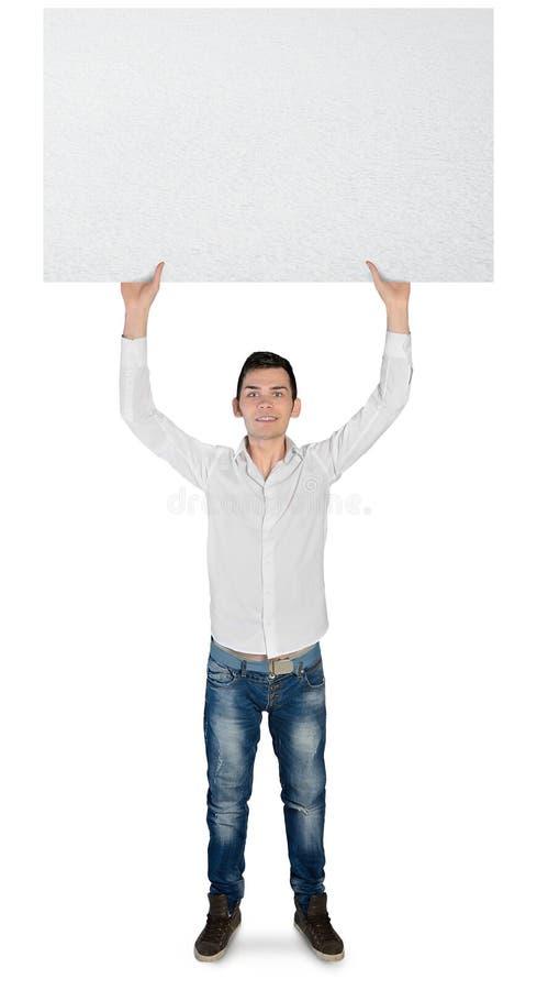 Hombre joven con el tablero vacío fotos de archivo