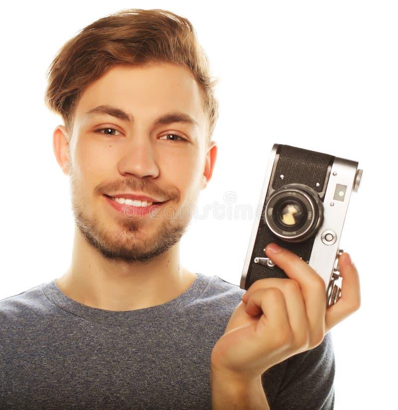 Hombre joven con la cámara Aislado sobre el fondo blanco fotos de archivo libres de regalías