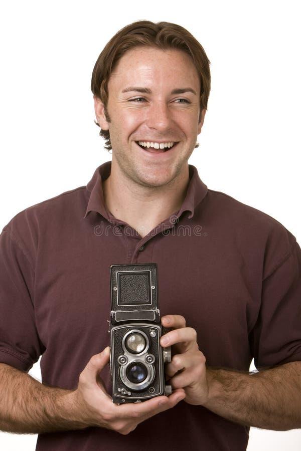 Hombre joven con la cámara de la vendimia fotografía de archivo libre de regalías