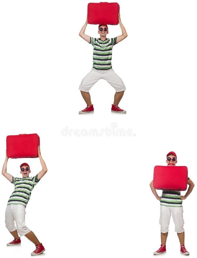 Hombre joven con la maleta roja aislada en blanco fotos de archivo libres de regalías