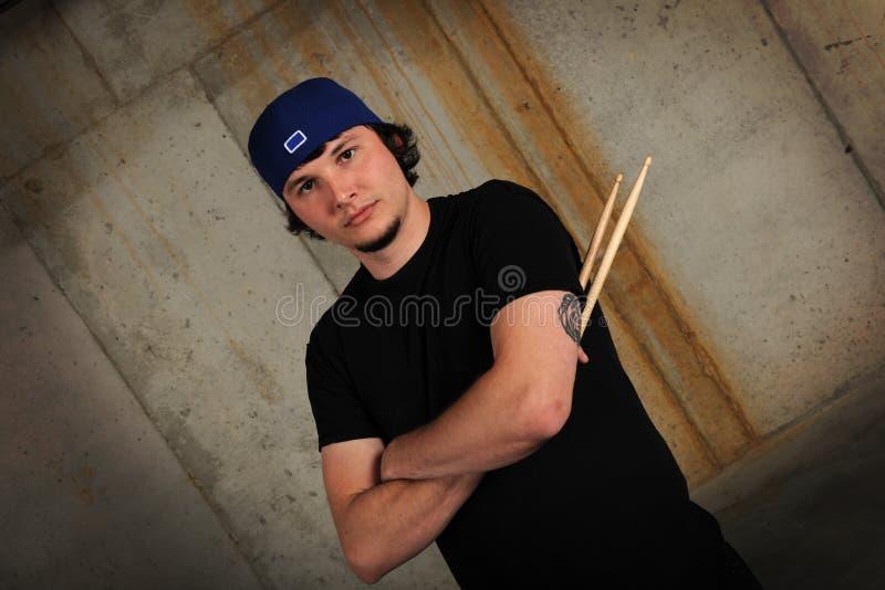 Hombre joven con los palillos fotografía de archivo libre de regalías